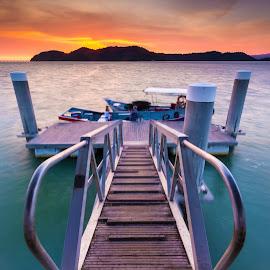 The Jetty by Rizal Zawawi - Landscapes Sunsets & Sunrises ( water, orange, hill, mountain, link, ocean, malaysia, jetty, beach, boat, sky, sunset, penang, cloudy, rizal@zawawi, goldenhour, golden )