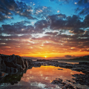 Sunset reflection by Adrian O'Neill - Landscapes Sunsets & Sunrises ( water, sky, sea, rocks, sun,  )