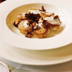 Scallops With Confit Potatoes And A Ginger And Thyme Velouté