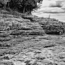 Small cliff by Keith Homan - Landscapes Travel ( shore, wisconsin, rocky, lakes, stone, door, rock, aquamarine, coastline, landscape, cave, coast, nature, shoreline, cloudy, rugged, water, clouds, boulders, shallow, stoney, cliff, midwest, horizon, forest, lake, scenic, seascape, woods, point, great, county, blue, submerged, trees, summer, scenery, aqua, peninsula )