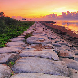 The  Light of Breakwater by Sunan Tara - Landscapes Sunsets & Sunrises ( water, bali, color, breakwater, sanur, land, stone, beach, sunrise, seascape, landscape, sun )