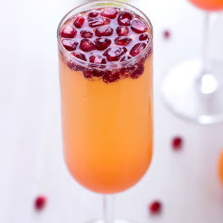 Tangerine Pomegranate Champagne Cocktail