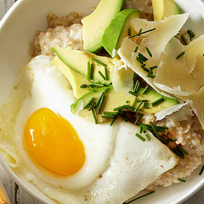 Oatmeal with Sunny-Side Up Eggs, Avocado, Cheddar and Chives