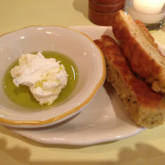 Bread before dinner with olive oil and ricotta. Yum!