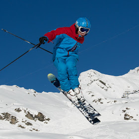 Skier in blue outfit doing a jump.jpg