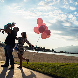 The family is the nucleus of civilization. by Yansen Setiawan - People Family ( happy, silhouette, family, balloon, portrait )