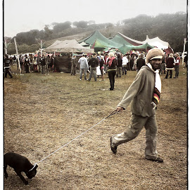 Walking the Rasta by Leslie Willmers - People Street & Candids ( field, leash, walking, tent, dog, rasta, party )