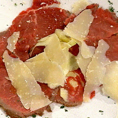 Seared Beef Carpaccio with Shaved Fresh Artichokes and a Drizzle of Truffle Oil