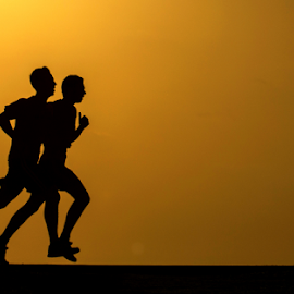 Runners at sunset by Yuval Shlomo - Sports & Fitness Fitness