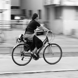 By the way by Amit Zakay - Transportation Bicycles ( panning, black and white, riding, city, bicycle, Bicycle, Sport, Transportation, Cycle, Bike, ResourceMagazine, Outdoors, Exercise, Two Wheels,  )