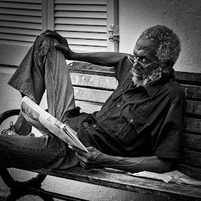 Bermuda News by Ed & Cindy Esposito - People Street & Candids ( bench, news, st. george's, bermuda, newspaper )
