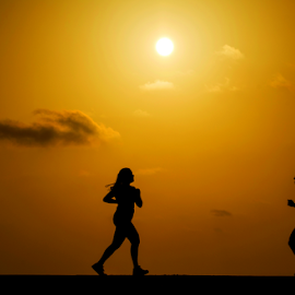 Men and women between the sun by Yuval Shlomo - Sports & Fitness Fitness