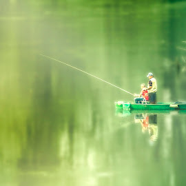 the fisherman by Kim Milar - Landscapes Waterscapes ( water, reflection, green, green background, fishing, fisherman,  )