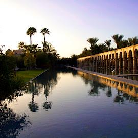 Palais Namaskar, Morocco by Chris Futcher - City,  Street & Park  Vistas ( water, marrakech, tranquil, mrocco, sunset, hotel, evening )