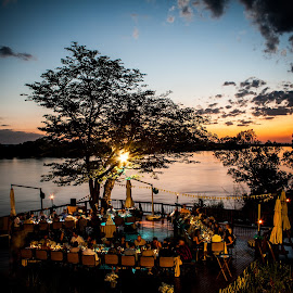 By the Zambezi by Werner Booysen - Wedding Reception ( wedding photos destination, wedding photography, sunset, wedding day, wedding, zambia, zambezi, werner booysen )
