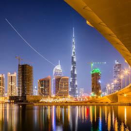 Dubai Skyline 3 by Cesar Crusat - City,  Street & Park  Skylines ( emirates, reflection, skyline, cityscape, travel, business, towers, city view, dubai, puente, long exposure, nikon, downtown, helicopter, office, building, larga exposicion, vivid colors, lake, skycrapers, burj khalifa, lago, d7100, uae, bridge, travel photography )