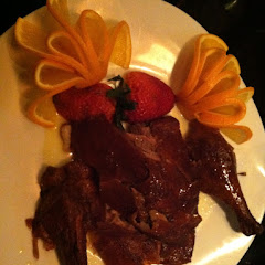 Duck A L'Orange: crispy skin and homemade orange reduction.