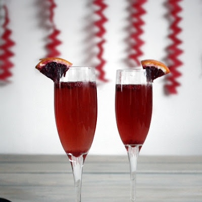 Blood Orange-Pomegrante Champagne Cocktail