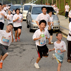 runners by Woo Yuen Foo - Sports & Fitness Running