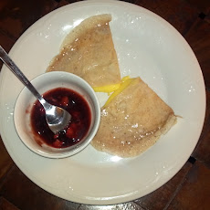 Tangerine Crepes With A Side Of Strawberry Reduction Sauce