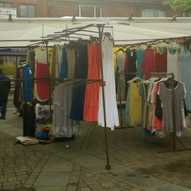 clothes stall by Lyz Amer - City,  Street & Park  Markets & Shops ( market )