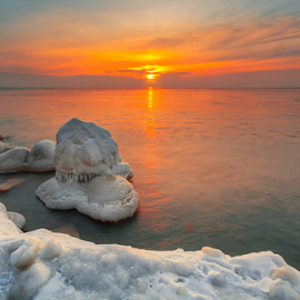 Bolder Point by Sushmita Sadhukhan - Landscapes Sunsets & Sunrises ( water, orange, ray, white, rock, yellow, morning, frozen, sun, winter, red, blue, sunset, ice, snow, sunrise, evening, light, bolder )