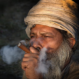 Bliss !! by Vinod Chauhan - People Portraits of Men ( priest, sulpha, baba, holy place, smoking, india, smoke )