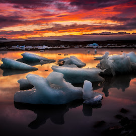 Sunrise on Ice. by Hallgrimur Helgason - Landscapes Sunsets & Sunrises ( iceberg, water, iceland, reflection, sky, ice, mood, sunrise, daybreak, light, dusk )