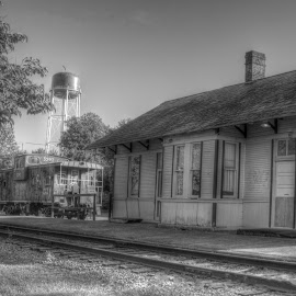 Waiting for the Train by Terri Hawk - Buildings & Architecture Public & Historical ( caboose, jackson, station, train, tracks, water tower )
