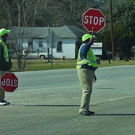 Volunteers Stopping traffic for school zone. by Terry Linton - City,  Street & Park  Vistas ( vistas, highway, stopsigns, working, people, street scenes,  )