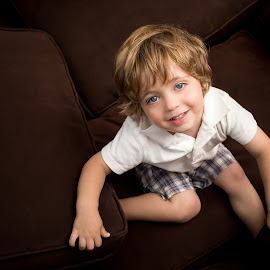 Cushion Pile by Mike DeMicco - Babies & Children Children Candids ( pillow, niko, cushion, fun, cute, eyes, child, couch, blue, happy, handsome, boy, cheerful, smiling )