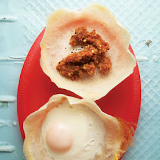 Hoppers (Sri Lankan Crêpes with Onion Sambol and Egg)