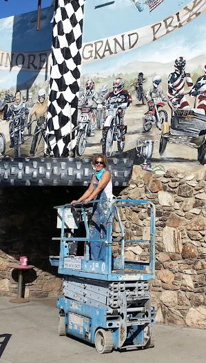 Artist Robin Golden at work on the mural, November 2014.