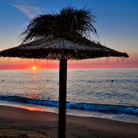 Sunrise by the sea by Alexandra Ciolan - Landscapes Beaches ( sand, blue sky, sunny, waves, umbrella, sea, beach, seascape )