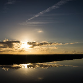 Sunset at marsh by Flemming Nielsen - Landscapes Cloud Formations ( clouds, mirrored reflections, wadden sea, sunset, clouds and sea, marsh, cloudscape )