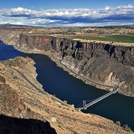 Palisades  by Andy Vic Lindblom - Landscapes Prairies, Meadows & Fields ( farm, clouds, field, oregon, cliffs, eastern cascades, road, bridge, madras, river )