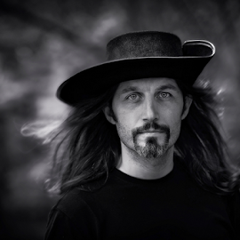 by Iva Petrović - People Portraits of Men ( musketeer cowboy hat man beard black and white hair )