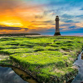 The Outflow by Marek Saj - Landscapes Sunsets & Sunrises ( clouds, water, lantern, sky, green, beautiful, lighthouse, perspective, stones, fracture, rocks, colours, , Hope )