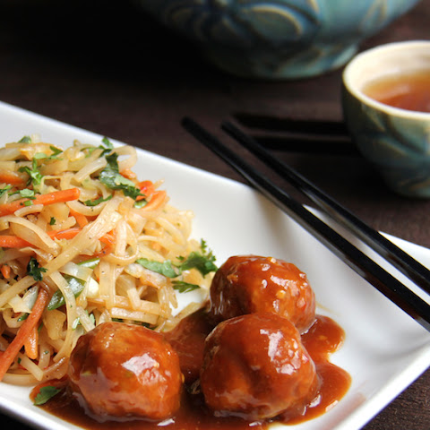 Hoisin-Glazed Pork Meatballs and Rice Noodles with Cabbage and Carrots