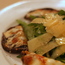 Grilled Portobello Mushrooms With Garlic, Cheese and Pine Nuts