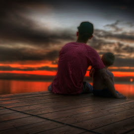 My son and I watching the sunset by Kyle Nelner - People Family