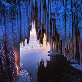 Ice Cave by Phil Koch - Landscapes Waterscapes ( vertical, farmland, yellow, cave, leaves, love, sky, tree, nature, autumn, snow, perspective, light, orange, art, agriculture, horizon, t  wilight, portrait, lake   michigan, environment, winter, dawn, season, serene, trees, lines, inspirational, shore, wisconsin, natural light, ray, summe  r, beauty, phil   koch, landscape, sun, photography, farm, ice, horizons, inspired, ice cave, clouds, office, park, green, beautiful, scenic, morning, shadows, field, red, blue, sunset, peace, meadow, beam, earth, sunrise )