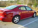 Our pretty little red Pontiac Grand Prix rental car.