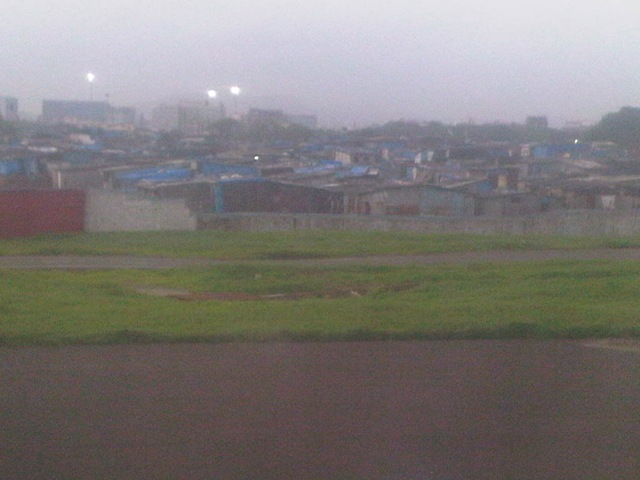 slums leading upto the runway