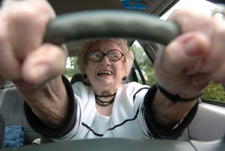 BC-WV--BC-PRI--Older Drivers--Eighty-seven-year-old Dorothy Wulfers, who learned to drive a Model T Ford at age 15, prepares to pull out of her parking space Friday, June 4, 2004 in Morgantown, WV. Wulfers said only her and God will decide when she stops driving. (AP PHOTO/DALE SPARKS)