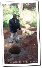 Foster, showing the shallow well he will be building a cement apron for to protect it from contamination.