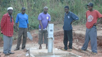 The well assembly team poeses for one final photo as Foster pumps the first bit of clean, safe water from this well.