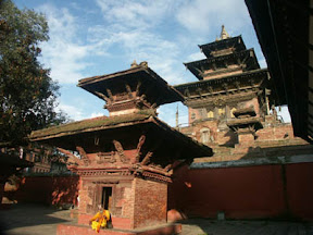 On the left on Durbar Square is the octagonal Krishna Temple which Pratapa Malla built in memory of two of his favorite queens