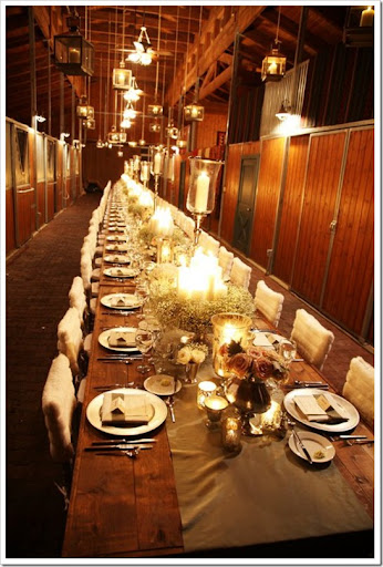 I love the horse barn the rustic table the hanging lanterns