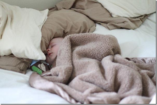 Kaden sleeping in our bed...